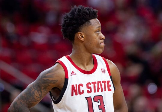 North Carolina State's C.J. Bryce (13) looks towards the stands as fans leave in the final minutes of an NCAA college basketball game against Virginia Tech in Raleigh, N.C., Saturday, Feb. 2, 2019. (AP Photo/Ben McKeown)