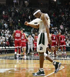 Cassius Winston walks to the bench in dejection as MSU falls to Indiana, 75-79, in overtime Saturday night.