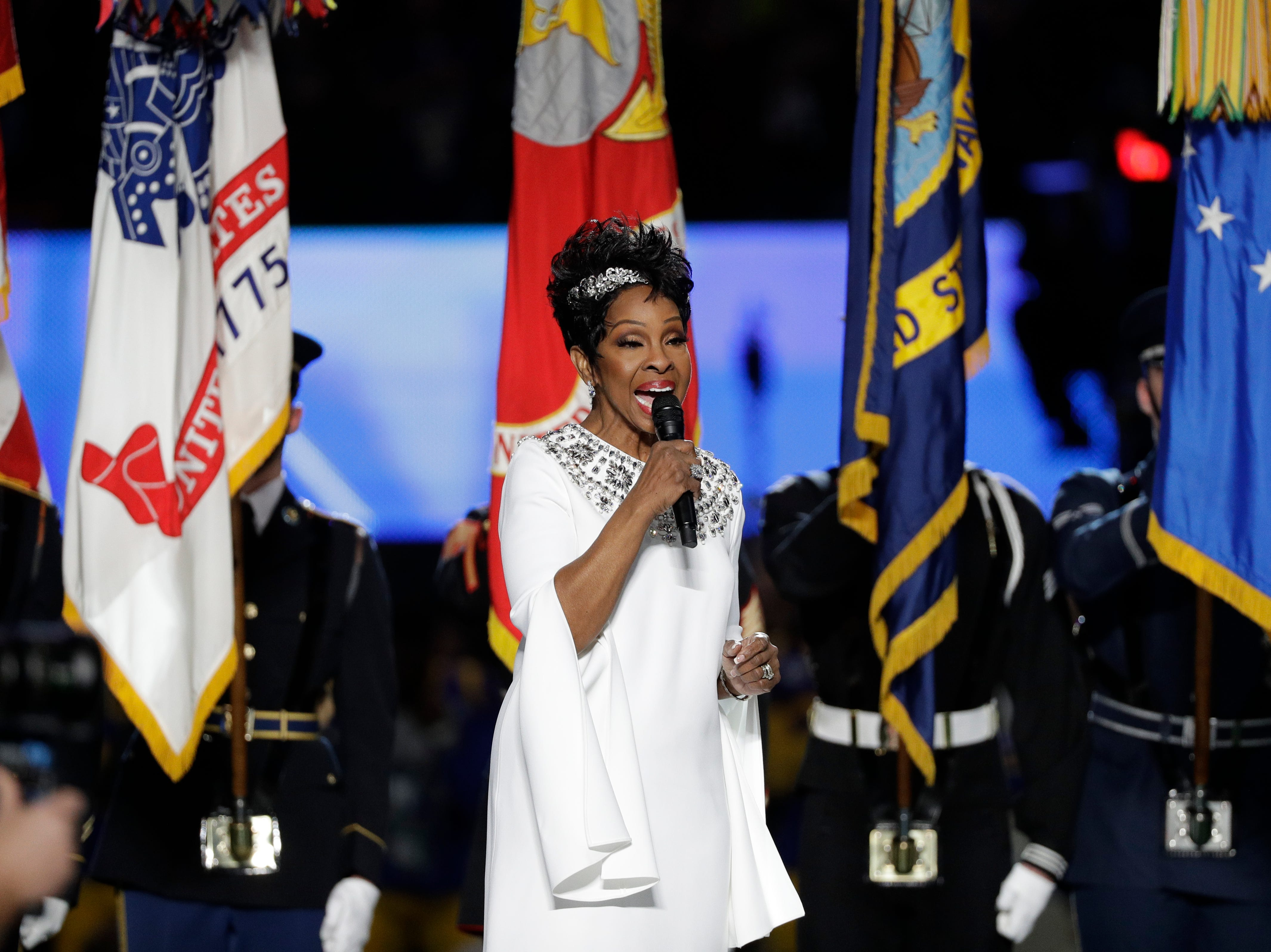 Gladys Knight sings the national anthem before the game.