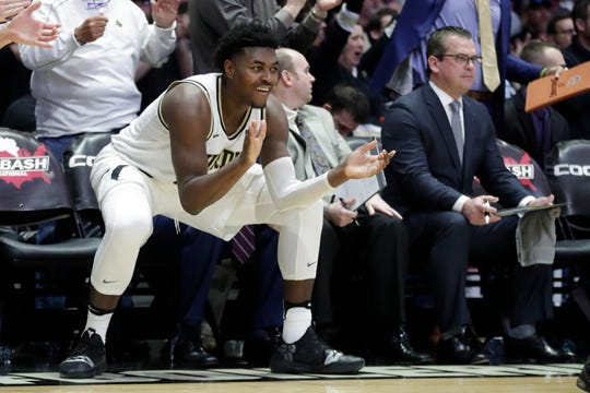 Purdue forward Trevion Williams celebrates on the bench during Sunday's win over Minnesota.