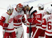 Red Wings goaltender Jonathan Bernier (45) celebrates with teammates Dennis Cholowski (21), Frans Nielsen (51) Jacob de la Rose (61) and Danny DeKeyser (65) after defeating the Senators on Saturday, 2-0.