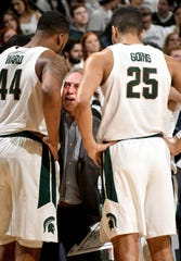 Tom Izzo gets after his big men in the huddle in the second half Saturday.