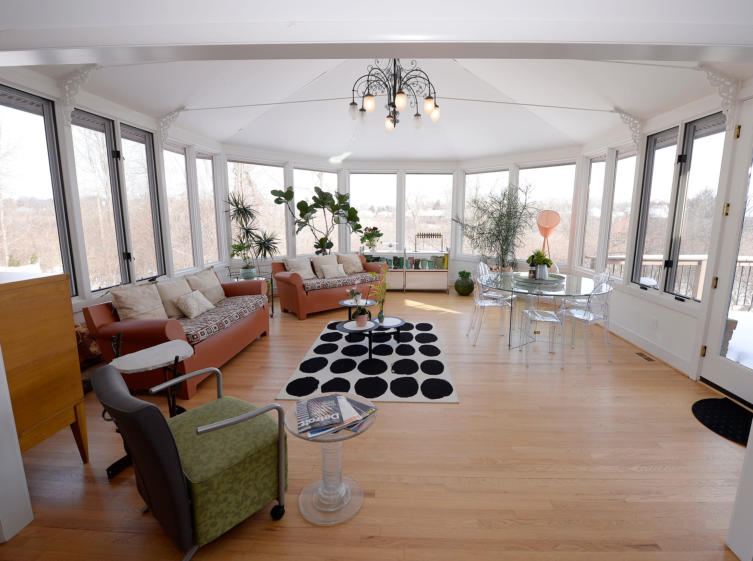 Conservatory room with open space and windows.