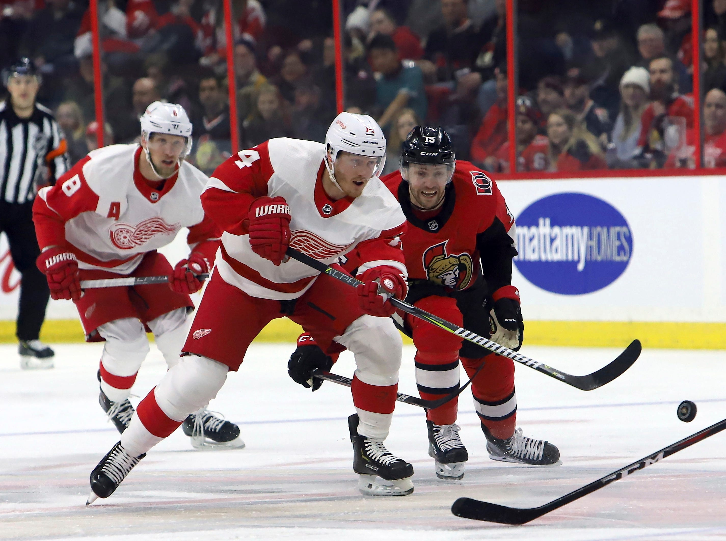 Ottawa Senators' Zack Smith (15) races for the puck against Detroit Red Wings' Gustav Nyquist (14) during first-period NHL hockey game action in Ottawa, Saturday, Feb. 2, 2019. (Fred Chartrand/The Canadian Press via AP)