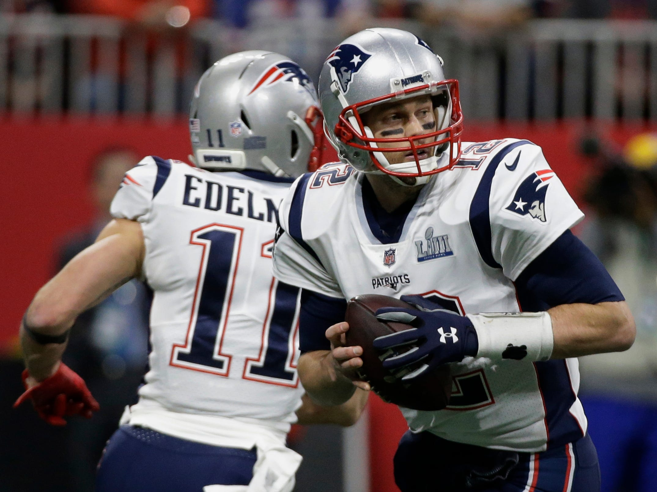New England Patriots' Tom Brady (12) looks to pass, during the first half.