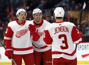 Detroit Red Wings' Danny DeKeyser (65) celebrates his goal against the Ottawa Senators with teammates Anthony Mantha (39) and Nick Jensen (3) during the first period Saturday. The Red Wings won 2-0.