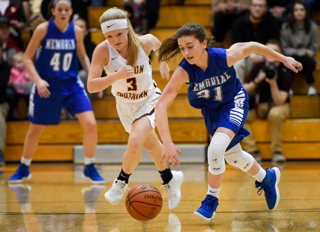 Gibson Southern's Maci Foster (3) and Memorial's Soffia Rieckers (31) chase a loose ball as the Gibson Southern Titans play the Memorial Tigers for the Class 3A Sectional Championship in Fort Branch Saturday, February 2, 2019.