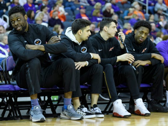 University of Evansville's Peace Ilegomah, left, sits on the bench with his teammates as his team takes on Valparaiso at Ford Center in February.