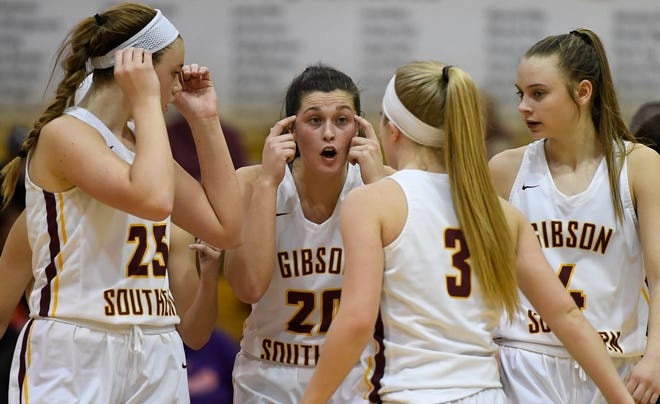 Gibson Southern's Tabby Klem (20) huddles with her teammates in the fourth quarter as the Gibson Southern Titans play the Memorial Tigers for the Class 3A Sectional Championship in Fort Branch Saturday, February 2, 2019.