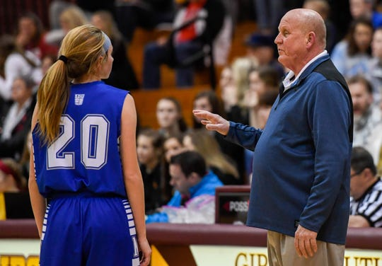 Memorial coach Bruce Dockery talks with Ryleigh Anslinger during the sectional championship against Gibson Southern. Dockery retired in March after 30+ years with the Tigers.