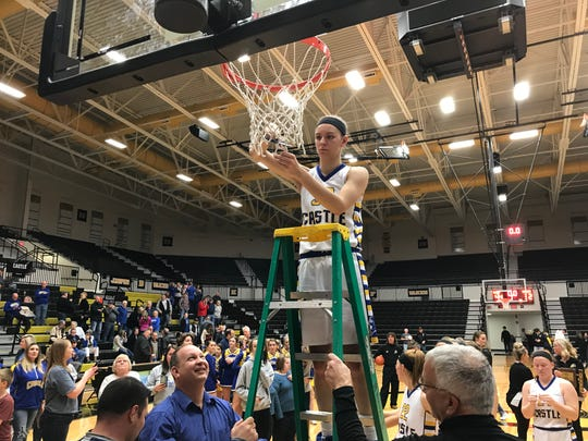 Jessica Nunge cuts down the net after Castle won its second straight Class 4A sectional title
