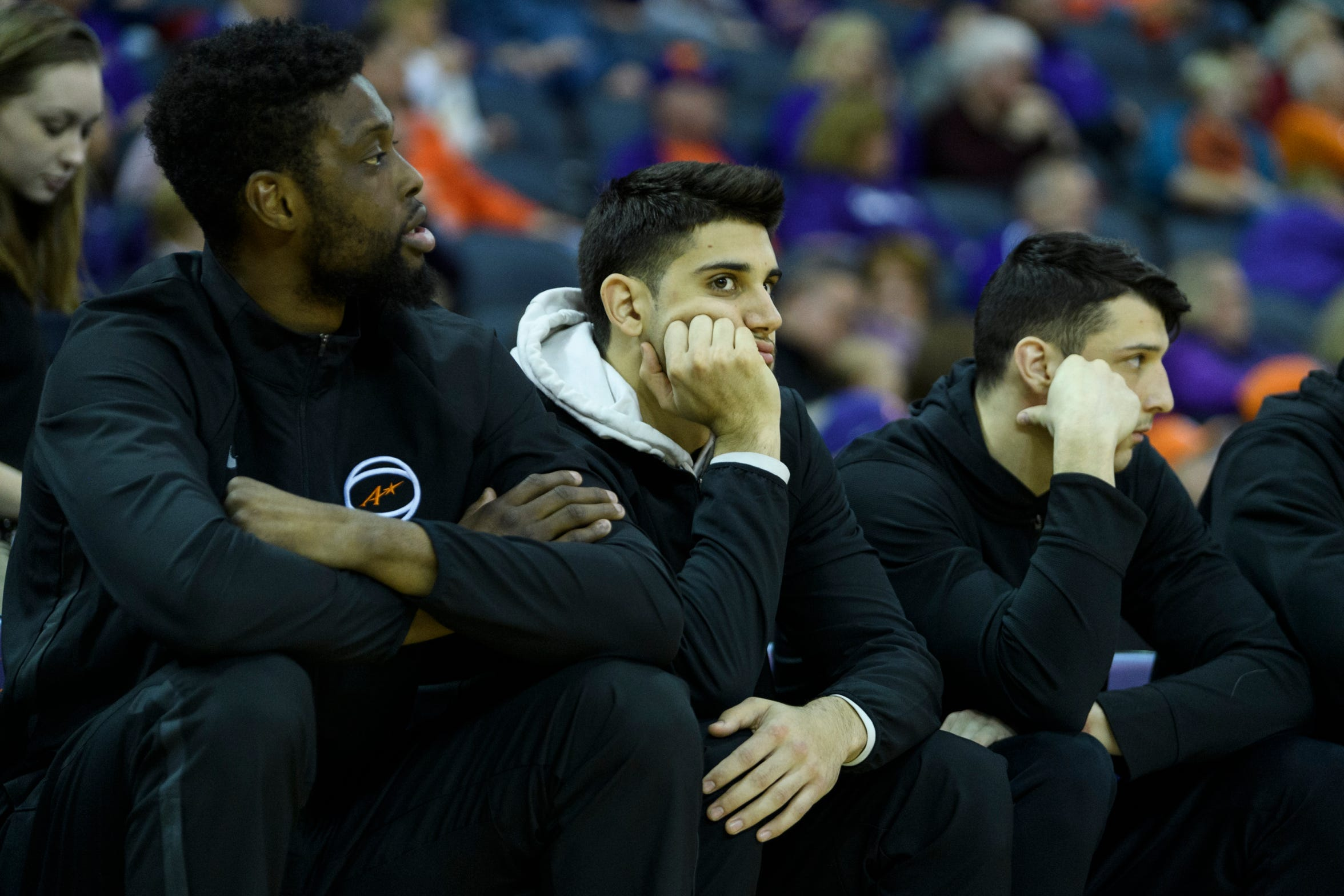 UE's transfer sitouts Peace Ilegomah (left), Sam Cunliffe (middle) and Art Labinowcz (right) watch their teammates against Valparaiso in February at Ford Center.