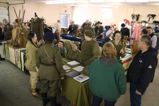 The 1st WAC Battalion portray members from the Women's Army Corps during the WWII era.