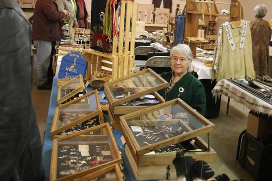 Peg Francisco, of Dancing Weasel Silver, displays her wares at the 29th annual Living History Trade Fair at the Sandusky County Fairgrounds this past weekend.
