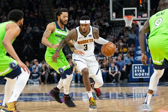 Torrey Craig, shown dribbling past Minnesota's Derrick Rose during a game Saturday night in Minneapolis, and the Denver Nuggets are on the road for three more games this week, beginning with a 5 p.m. contest Monday at Detroit.