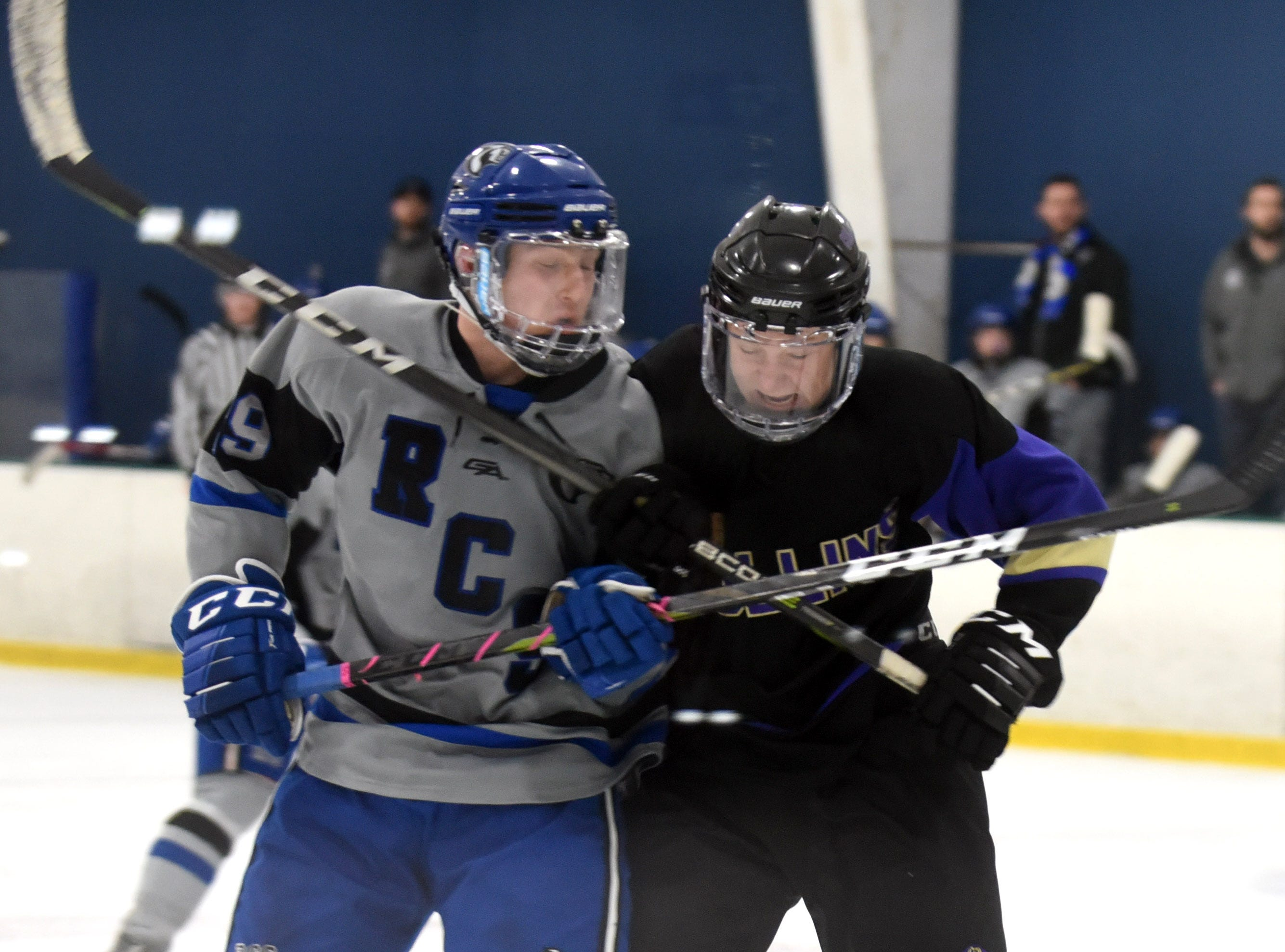 Resurrection Christian's Michael Lewis and Fort Collins' Bryce Hall check into each other during the game on Saturday, Feb 2, at NoCo Ice Center, 7900 N Fairgrounds Ave, in Fort Collins.