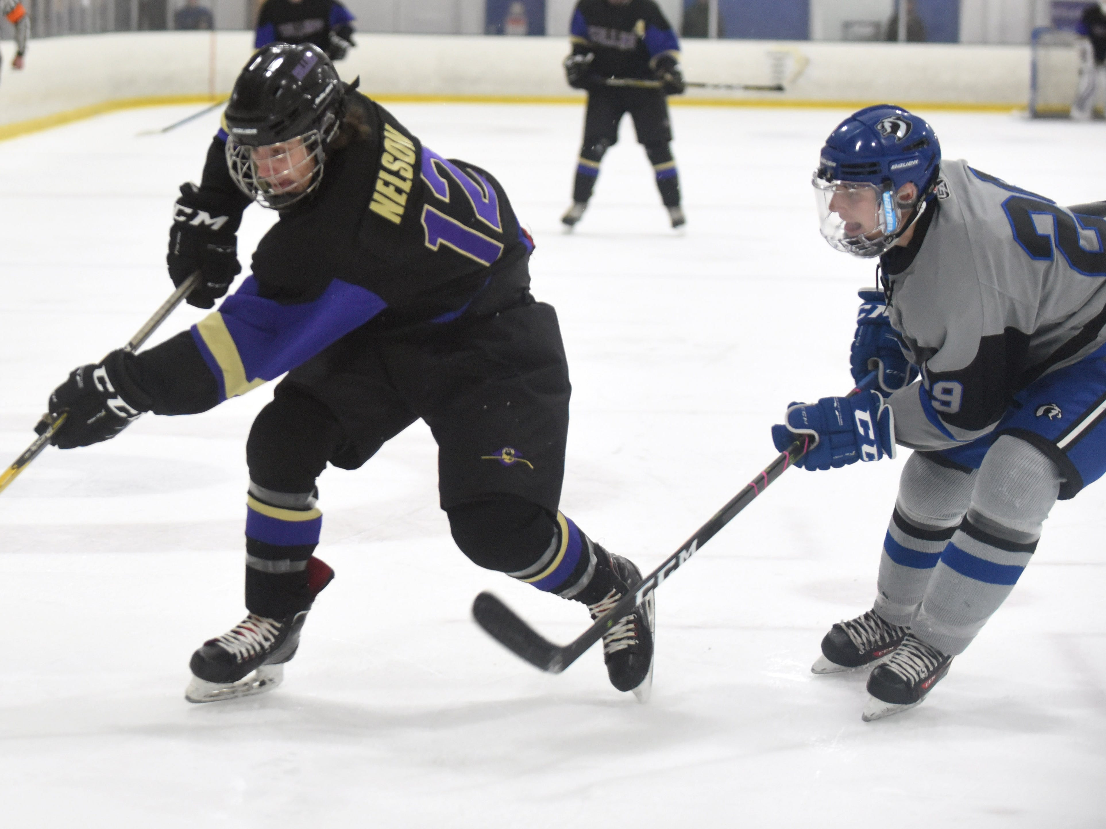 Fort Collins' Ethan Nelson keeps the puck away from Resurrection Christian's Michael Lewis during the game on Saturday, Feb 2, at NoCo Ice Center, 7900 N Fairgrounds Ave, in Fort Collins.