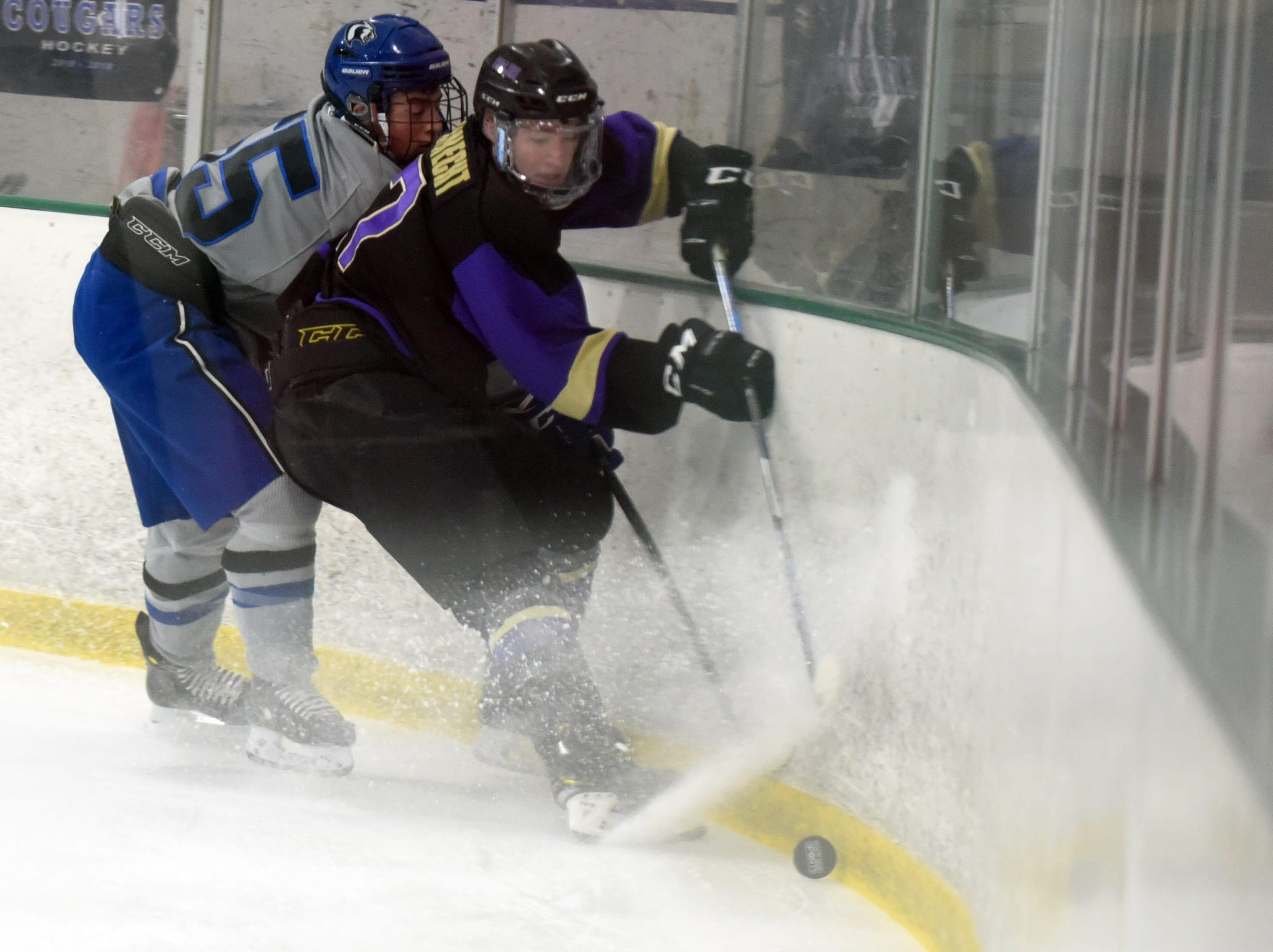 Fort Collins' Marc DuHadway tries to break away from Resurrection Christian's Eric Tyrrell during the game on Saturday, Feb 2, at NoCo Ice Center, 7900 N Fairgrounds Ave, in Fort Collins.