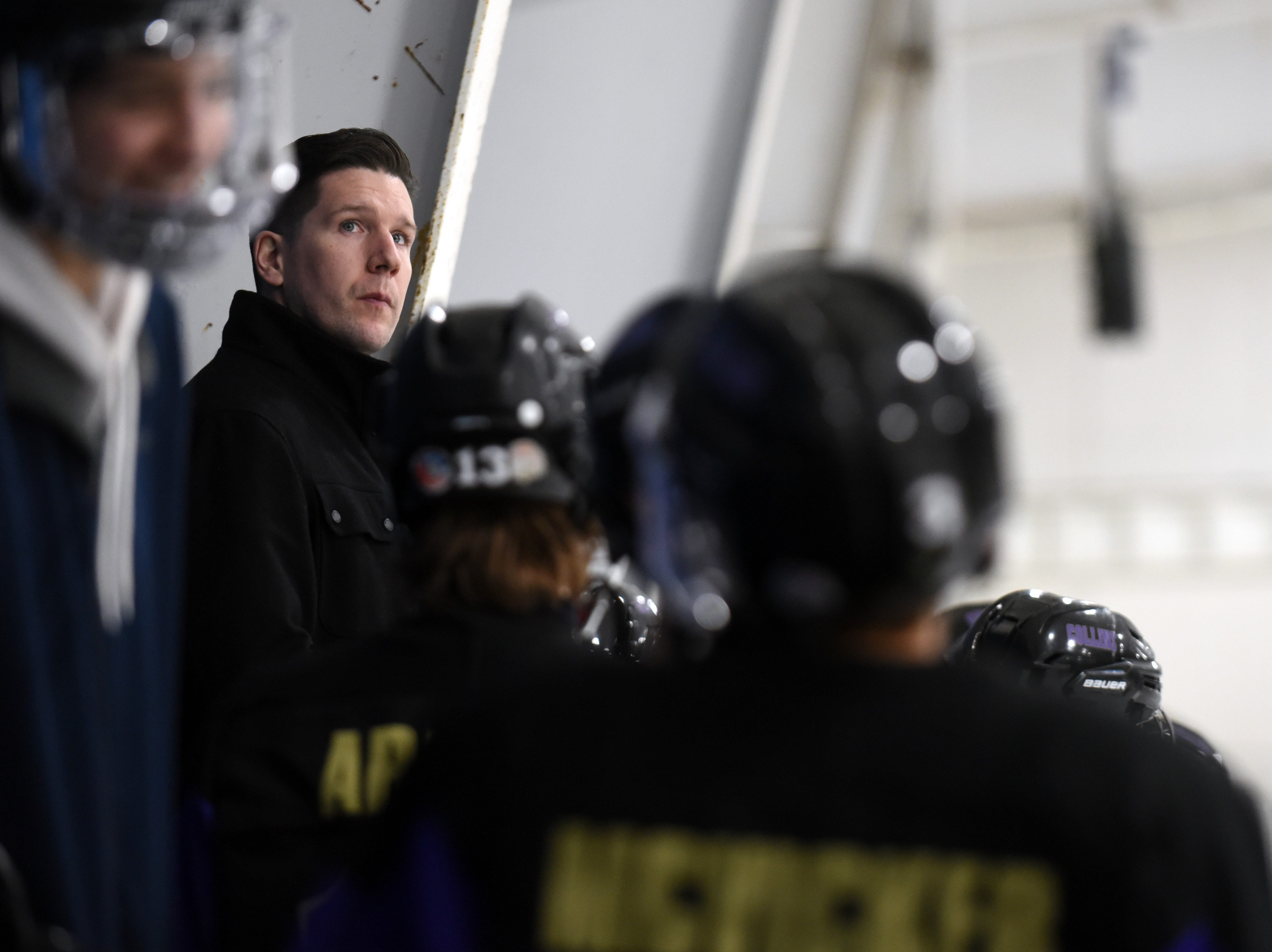 Fort Collins coach Dylan Strom looks up at the score board as he sits stands with his players during the game on Saturday, Feb 2, at NoCo Ice Center, 7900 N Fairgrounds Ave, in Fort Collins.