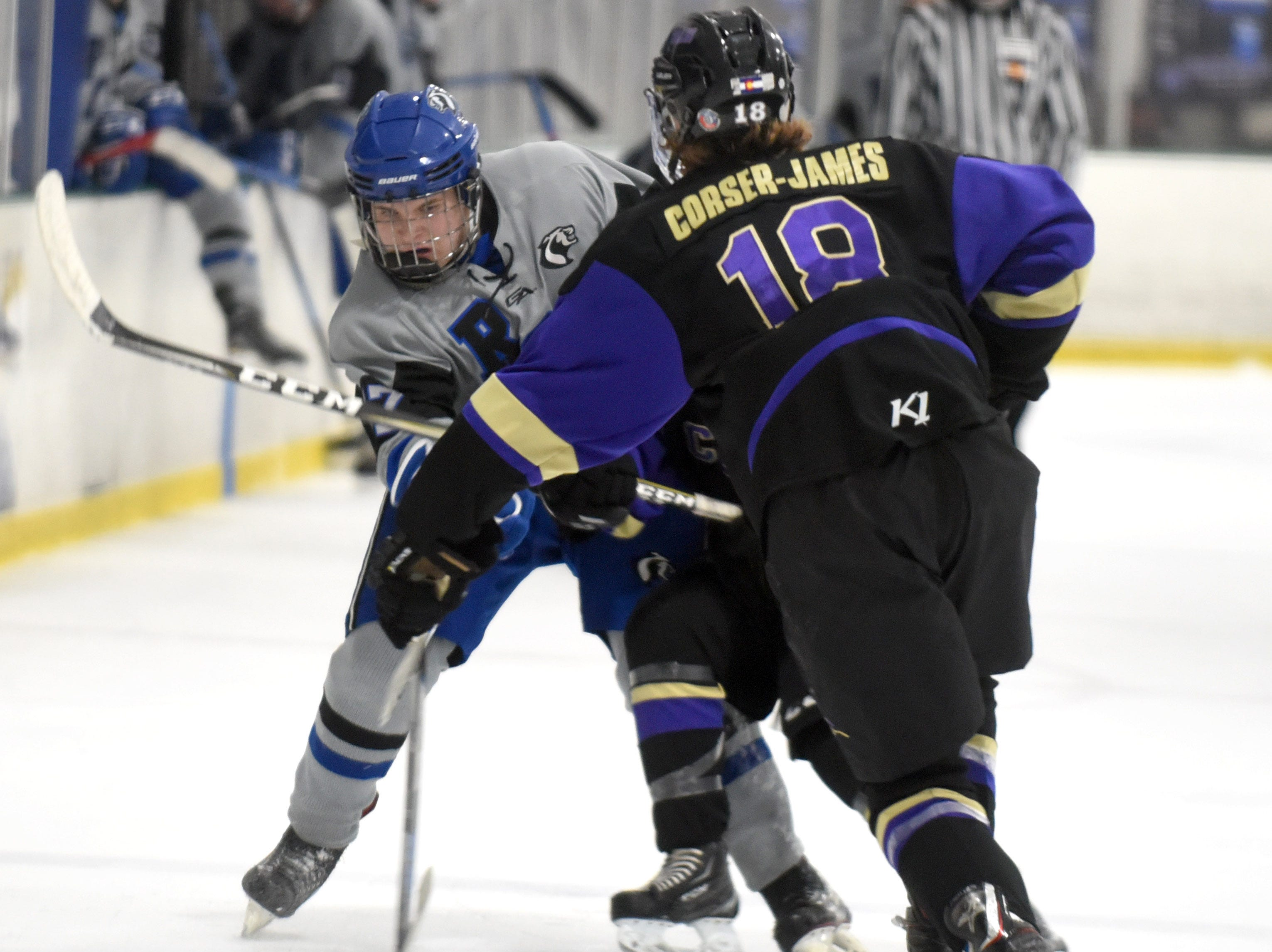 Resurrection Christian's Treighton Tadlock tries to shot around Fort Collins' Jesse Corser-James during the game on Saturday, Feb 2, at NoCo Ice Center, 7900 N Fairgrounds Ave, in Fort Collins.