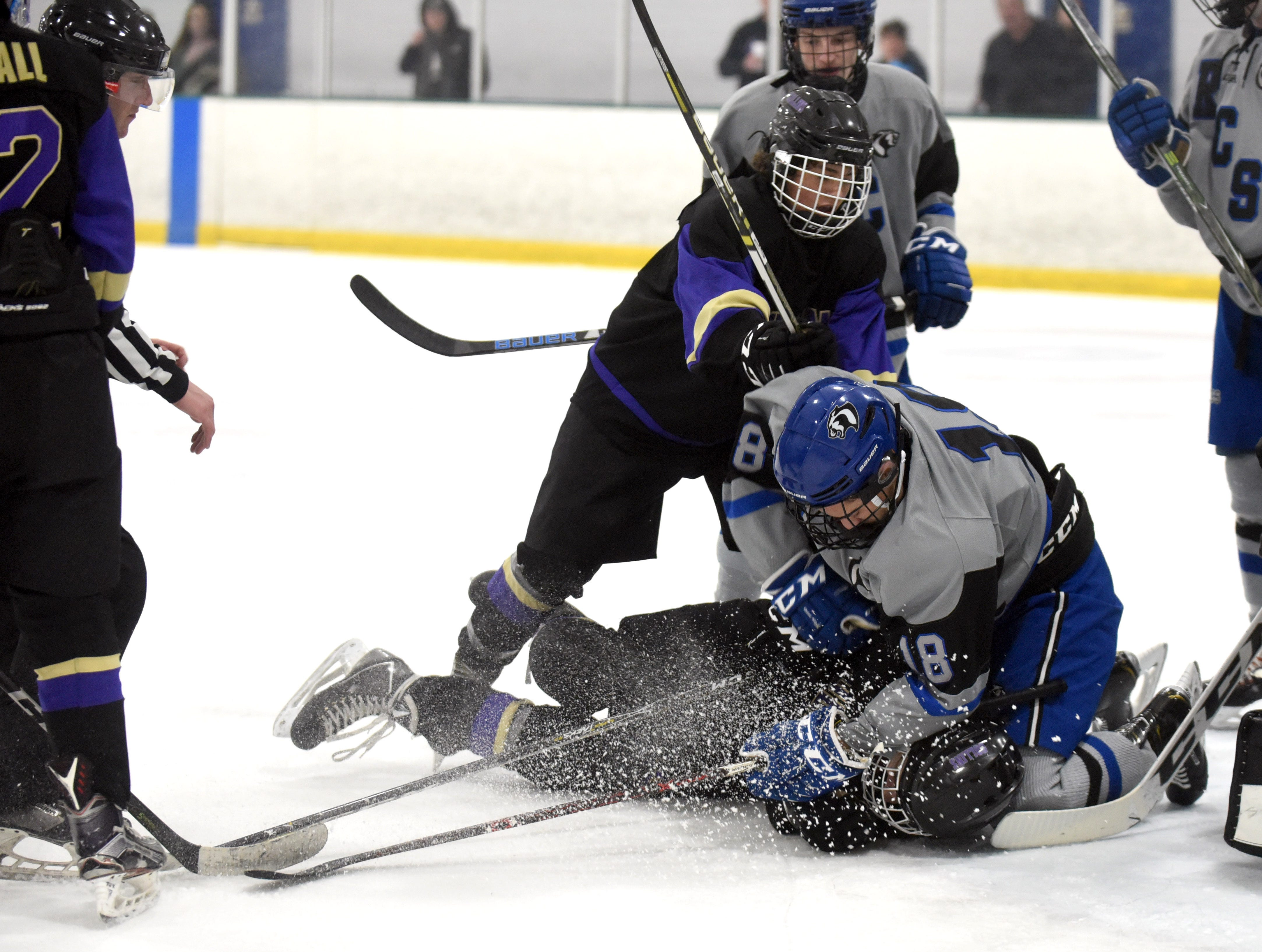 A fight breaks out between Fort Collins' Bryce Hall and Resurrection Christian's Perry McIntire in front of the Resurrection Christian goal during the game on Saturday, Feb 2, at NoCo Ice Center, 7900 N Fairgrounds Ave, in Fort Collins.