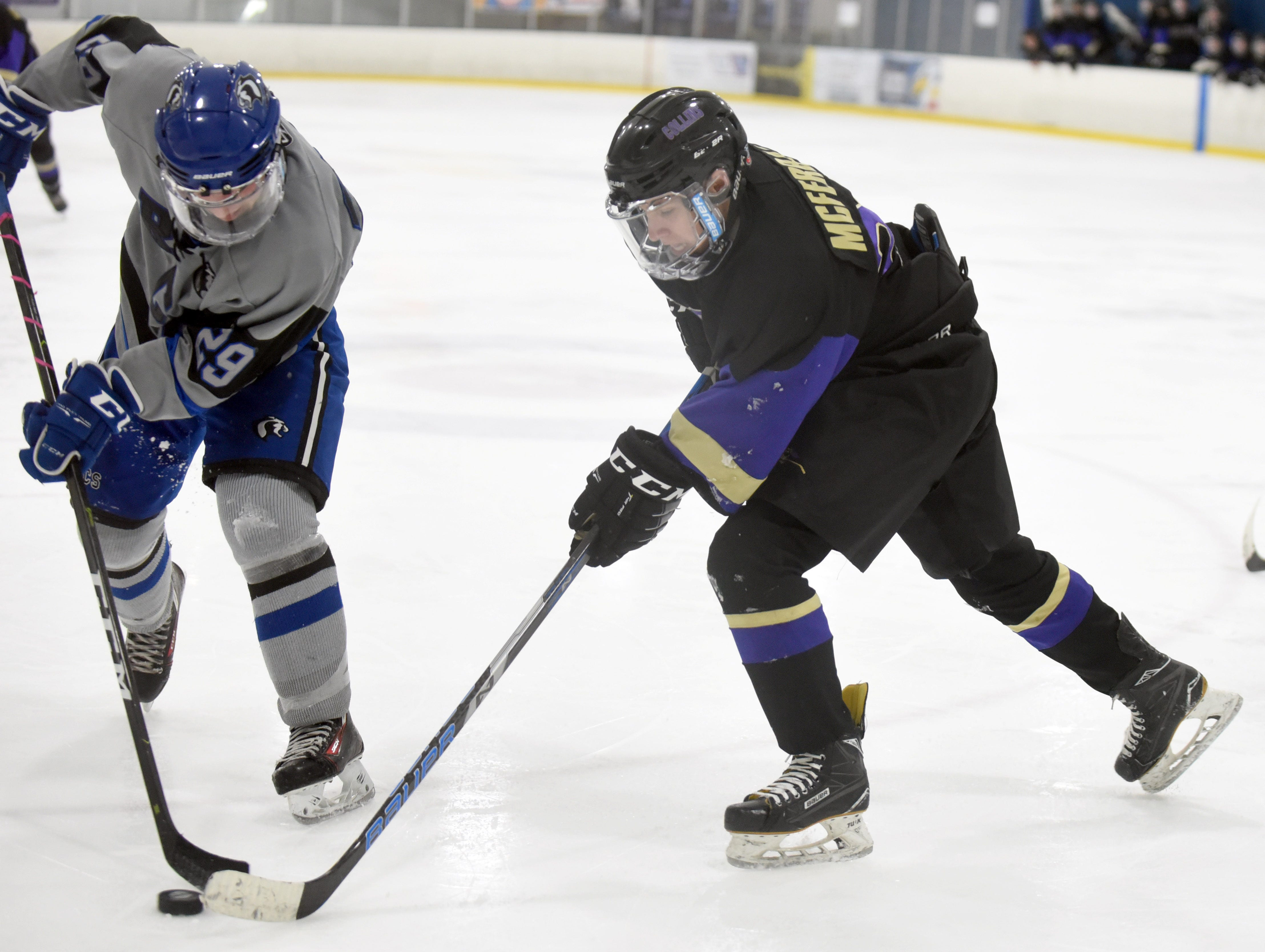 Fort Collins' Jared McFerran tries to dribble the puck around Resurrection Christian's Michael Lewis during the game on Saturday, Feb 2, at NoCo Ice Center, 7900 N Fairgrounds Ave, in Fort Collins.