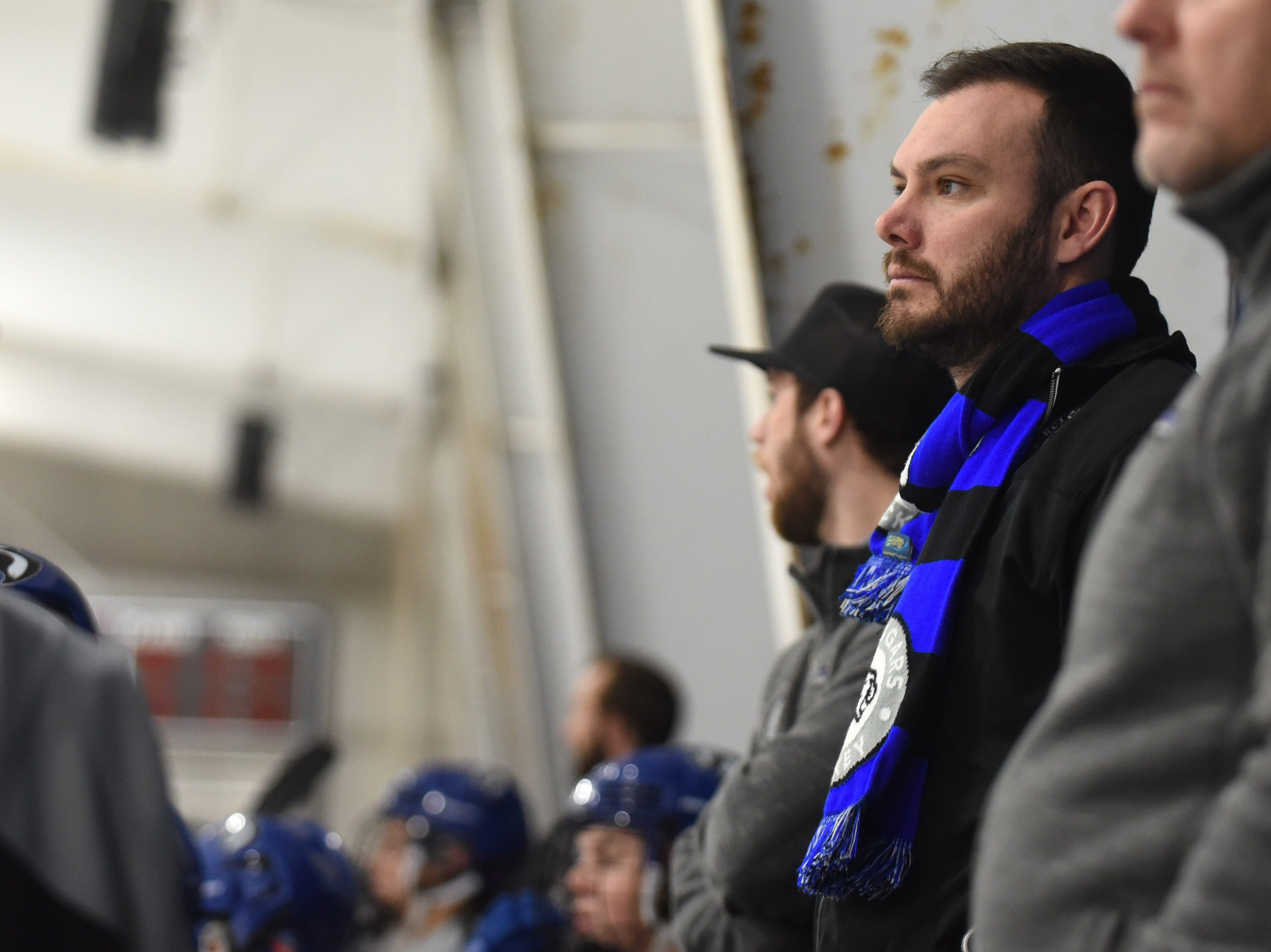 Resurrection Christian coach Jake Pence watches from the bench during the game against Fort Collins on Saturday, Feb 2, at NoCo Ice Center, 7900 N Fairgrounds Ave, in Fort Collins.
