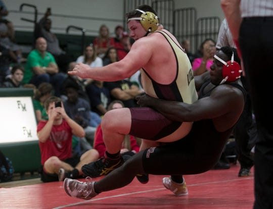 Adolphus Taylor of North Fort Myers wrestles T.J. Barfield of Riverdale in the 285-pound weight class final in the LCAC Wrestling Championships on Saturday, Feb. 2, 2019, at Fort Myers High School. Barfield won the match.