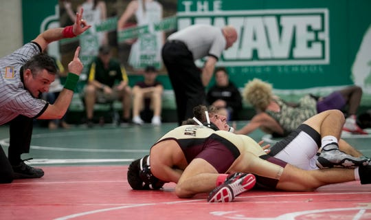 Jared Dinh of Riverdale wrestles Mack Koselke of Mariner in the 140-pound weight class finals of the LCAC Wrestling Championships on Saturday, Feb. 2, 2019, at Fort Myers High School. Dinh won the match.
