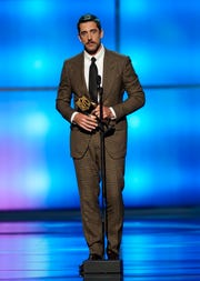 Aaron Rodgers of the Green Bay Packers accepts the award for the Moment of the Year at the 8th Annual NFL Honors at The Fox Theatre on Saturday, Feb. 2, 2019, in Atlanta.