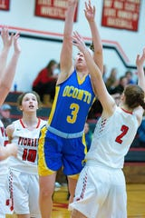 Oconto's Aubree Bucheger gets fouled on by Grace Brauer with Sevastopol in a game Jan. 18.