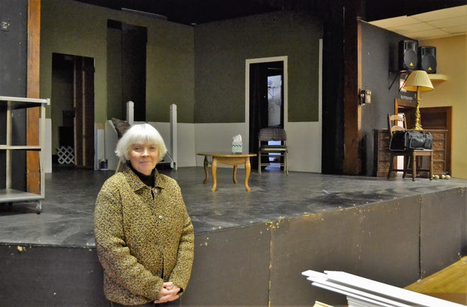 Kathy Campshure's 12th play, The Hopeful Hearts Dating Club of Oconto, will be presented Feb. 8-10 and 15-17 at the Machickanee Playhouse in Oconto.  Campshure, seen before the playhouse stage where the set was still under construction, is also directing, as she as her previous plays.