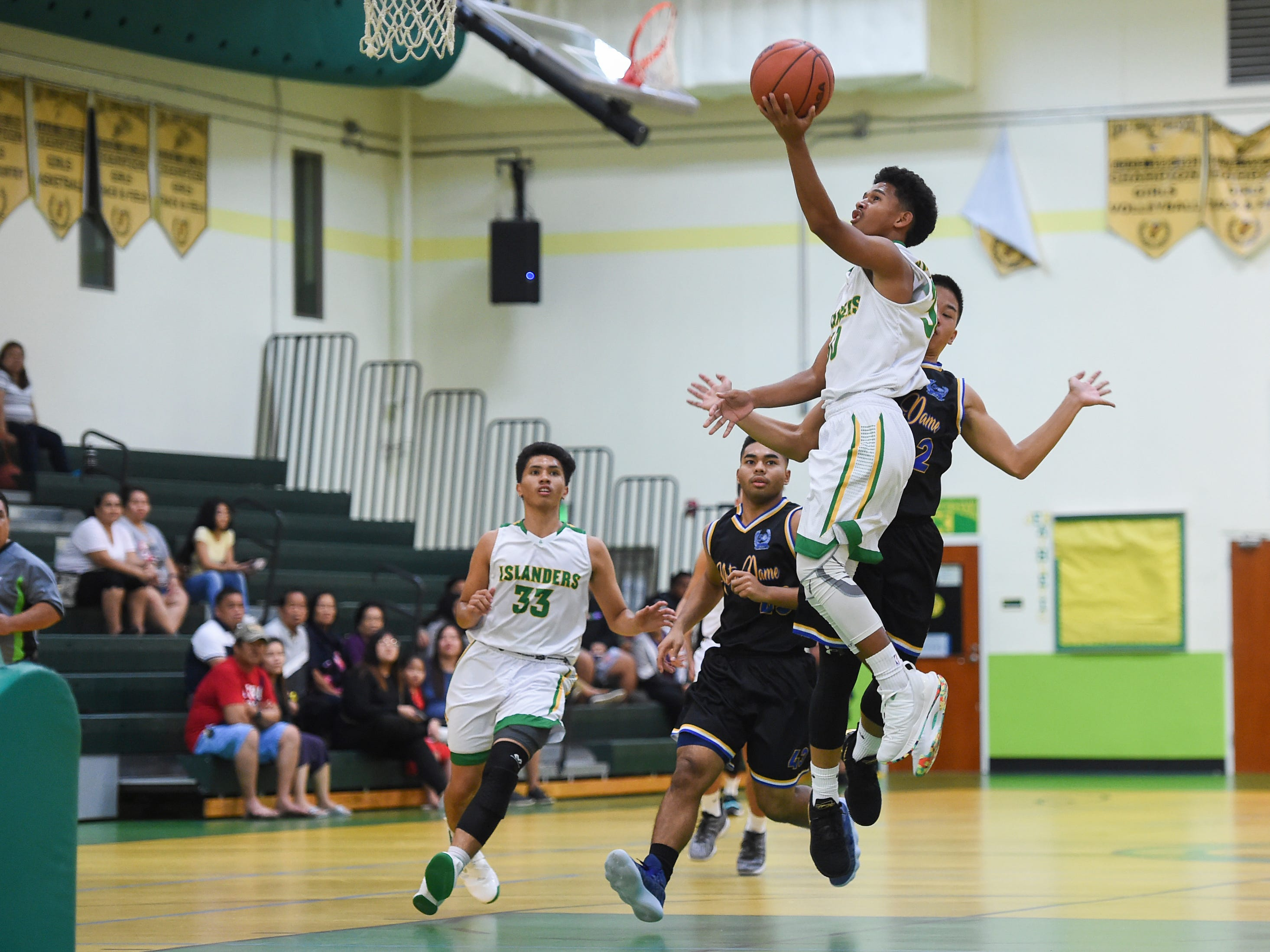 Jeremiah Kintoki drives to the basket for the John F. Kennedy Islanders during their Independent Interscholastic Athletic Association of Guam Boys' Basketball game against the Notre Dame Royals at the JFK High School Gym, Feb. 2, 2019.
