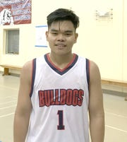 The Okkodo Bulldogs' Dale Bautista finished with 16 points to lead his team to a 60-56 victory over the Father Duenas Friars in a IIAAG Boys' Basketball League matchup at the Okkodo gym.