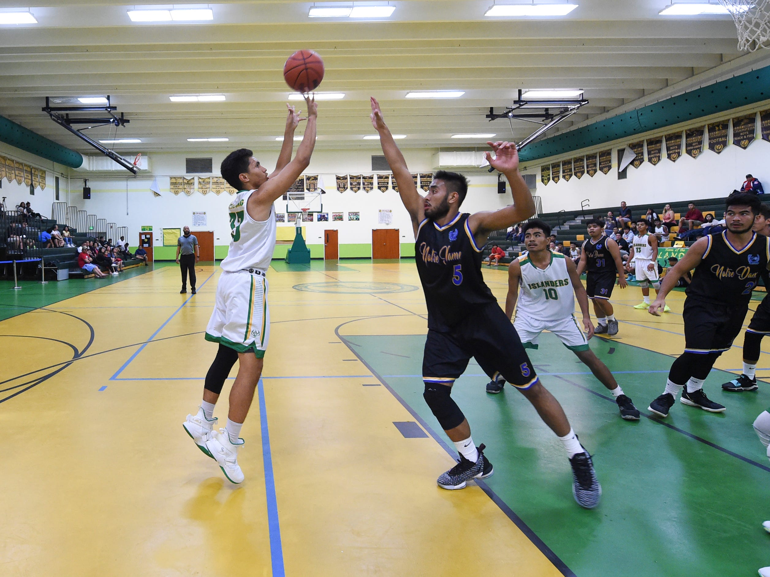 John F. Kennedy Islander Jeremiah Taitingfong shoots a jumpshot during an Independent Interscholastic Athletic Association of Guam Boys' Basketball game at the JFK High School Gym, Feb. 2, 2019.