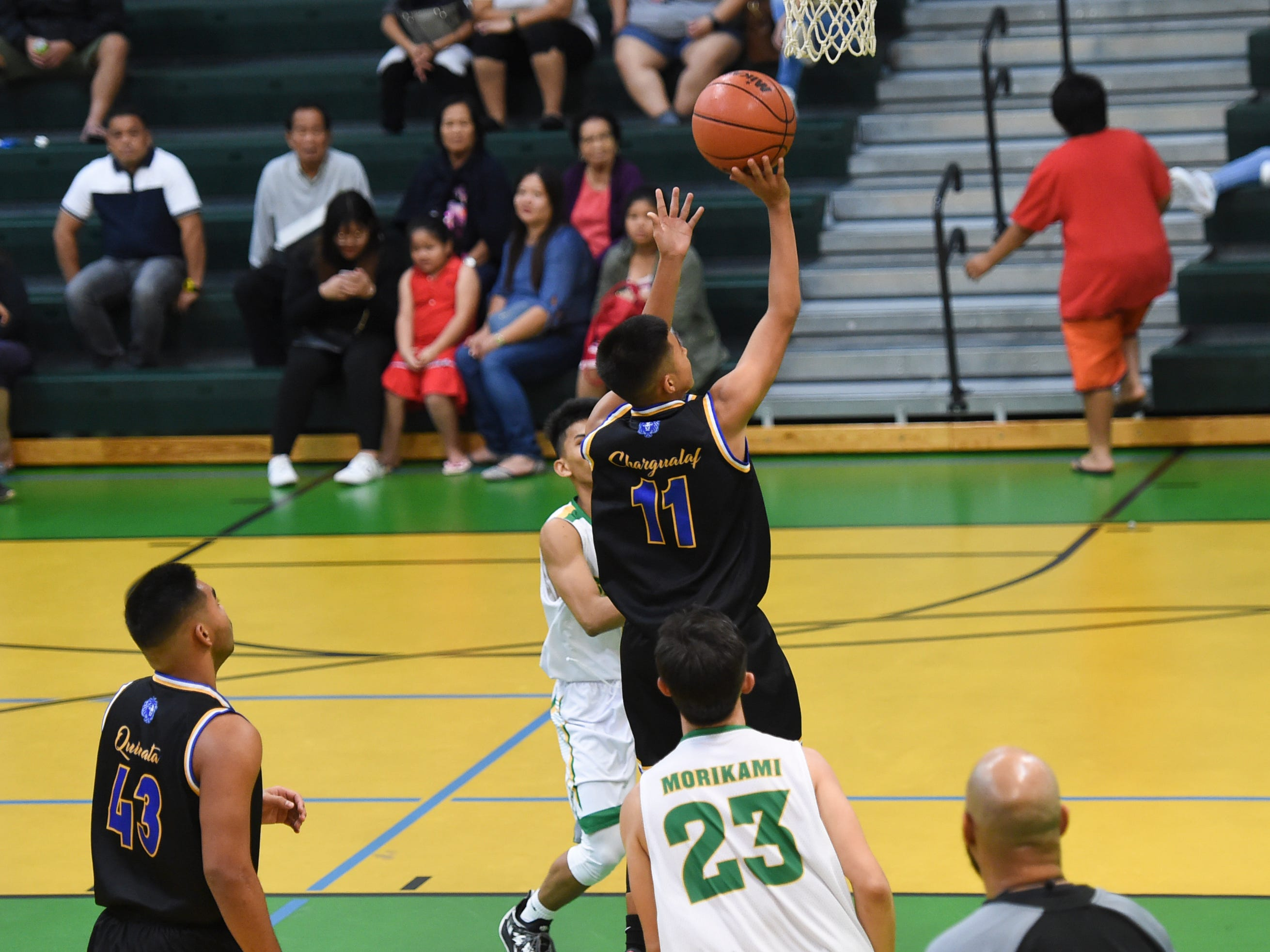 Bryce Chargualaf (11) scores on a layup for the Notre Dame Royals during an Independent Interscholastic Athletic Association of Guam Boys' Basketball game at the John F. Kennedy High School Gym, Feb. 2, 2019.