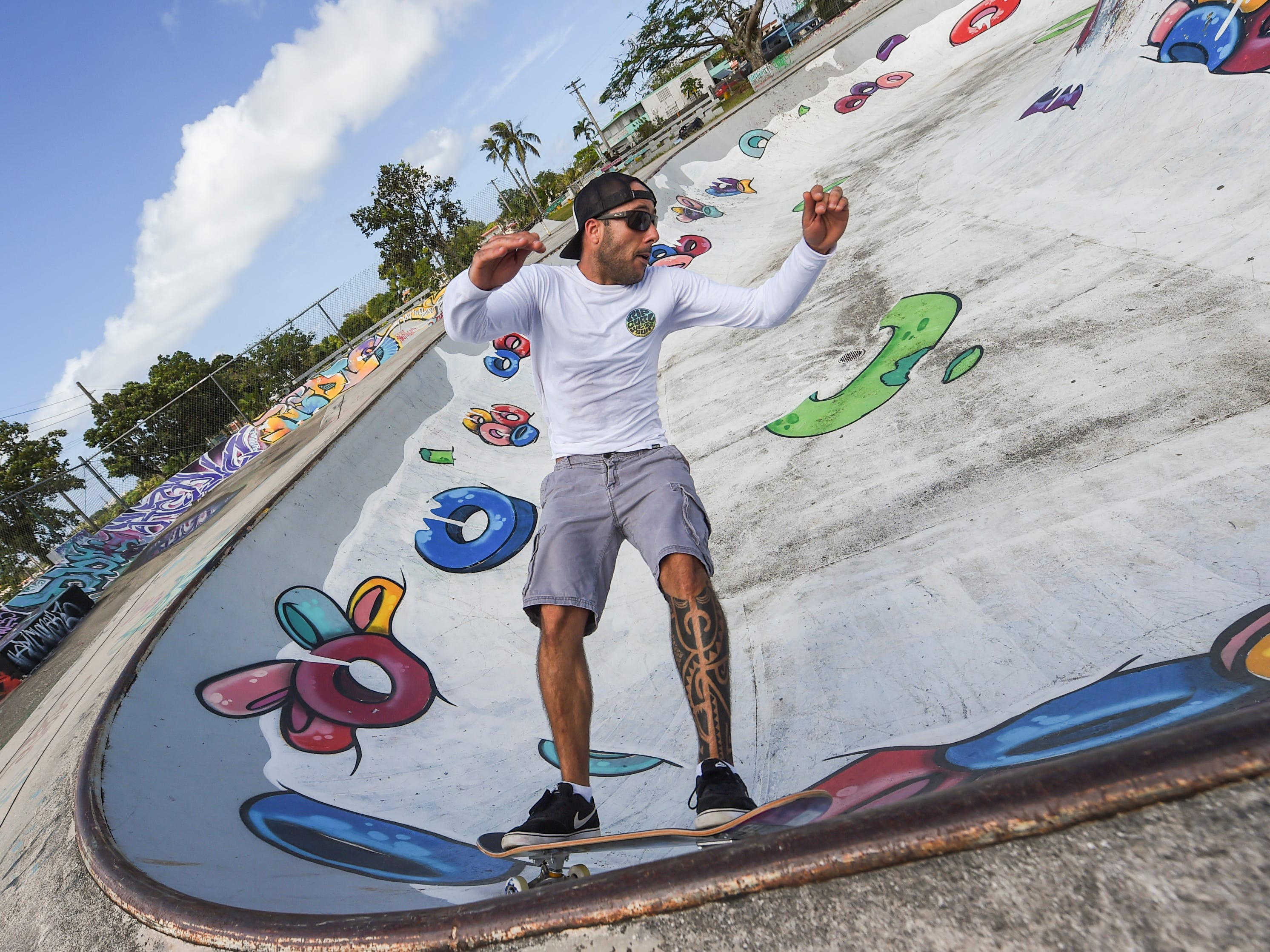 Vinnie Rodrigues rides a bowl at the Dededo Skatepark on Feb. 3, 2019.