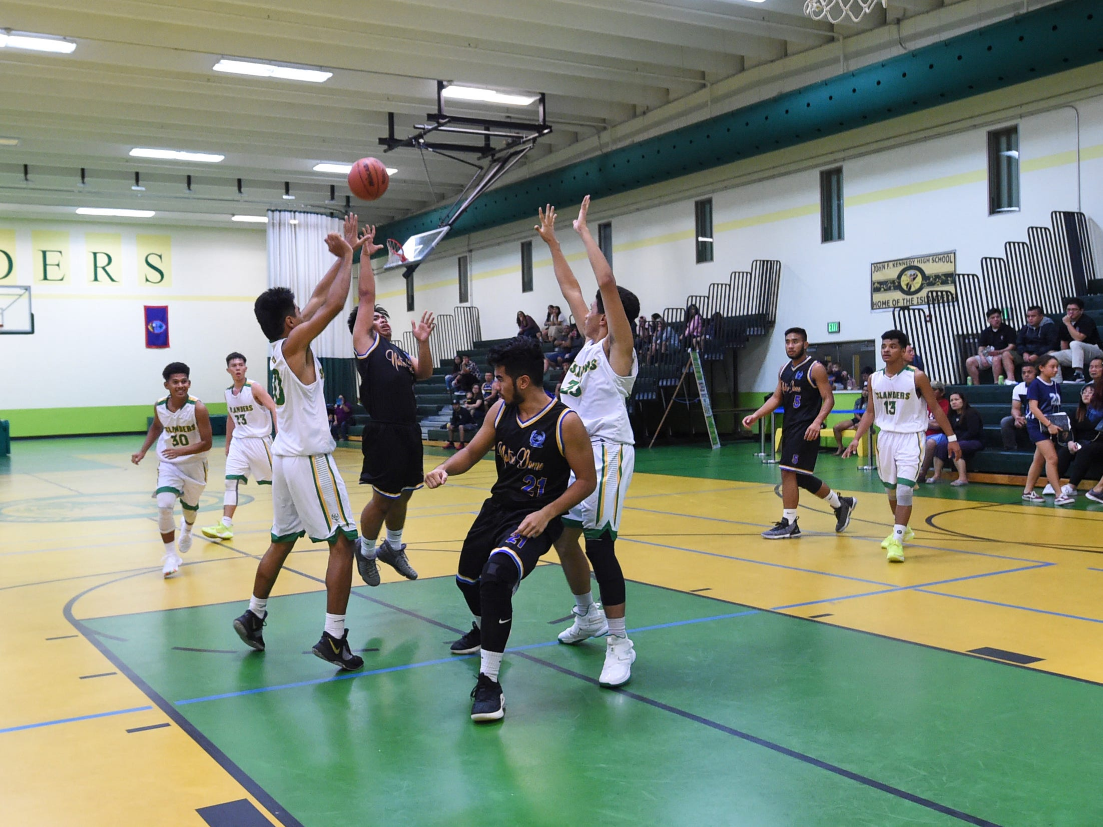 Notre Dame player Dean Diras attempts a floater against the John F. Kennedy Islanders during their Independent Interscholastic Athletic Association of Guam Boys' Basketball game at the JFK High School Gym, Feb. 2, 2019.