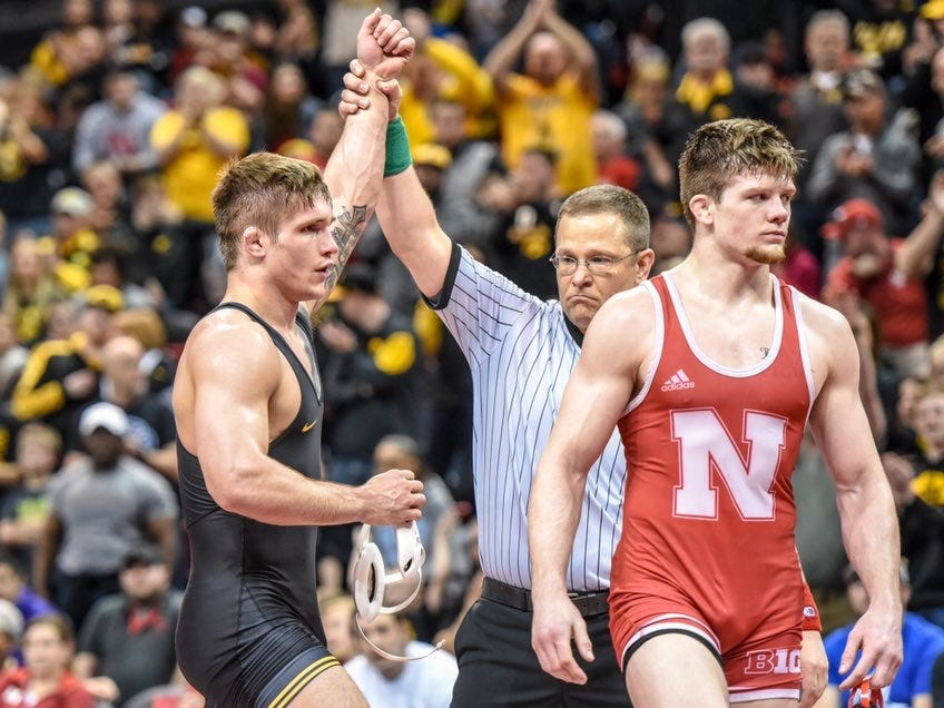 Iowa's Cash Wilcke gets his hand raised during Sunday's dual at the Bob Devaney Sports Center in Lincoln, Nebraska on Sunday, Feb. 3, 2019. Wilcke defeated Nebraska's Taylor Venz, 5-2.