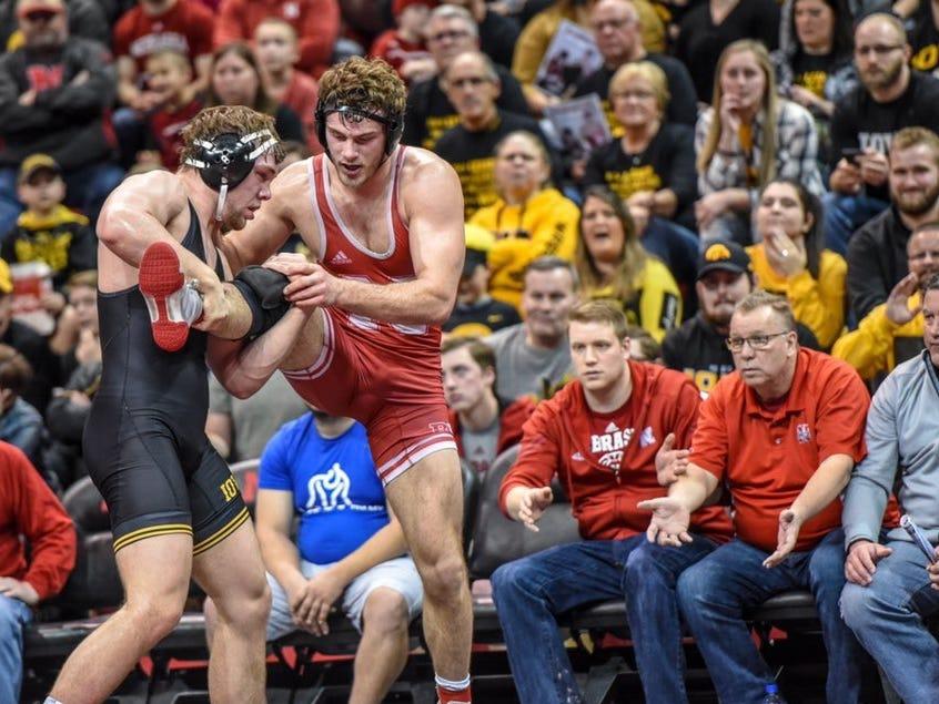 Iowa's Jacob Warner works for a takedown against Nebraska's Eric Schultz during Sunday's dual at the Bob Devaney Sports Center in Lincoln, Nebraska on Sunday, Feb. 3, 2019. Warner won, 4-1.