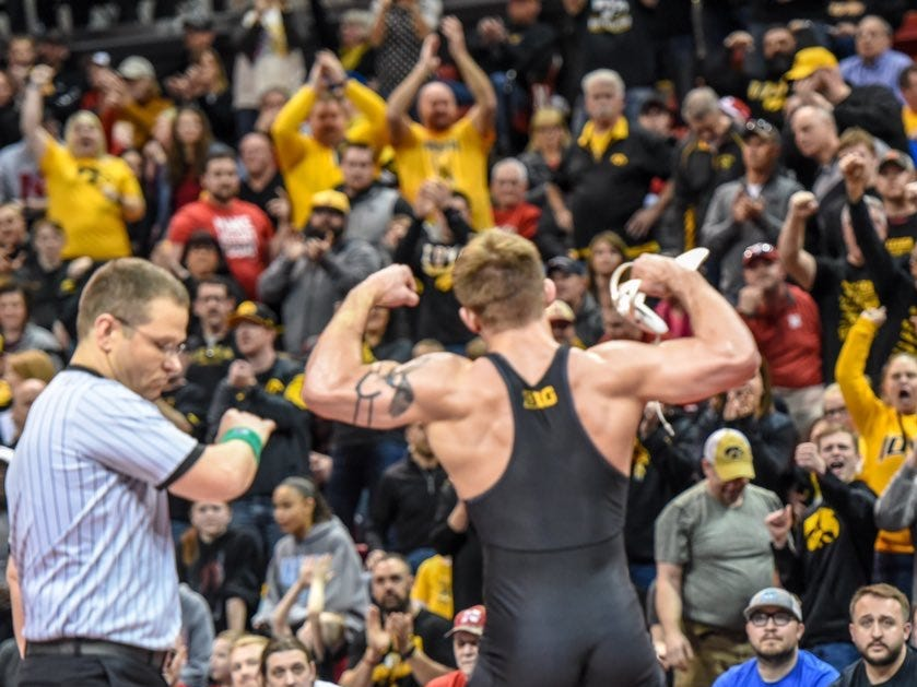 Iowa's Cash Wilcke flexes toward the Iowa crowd during Sunday's dual at the Bob Devaney Sports Center in Lincoln, Nebraska on Sunday, Feb. 3, 2019.