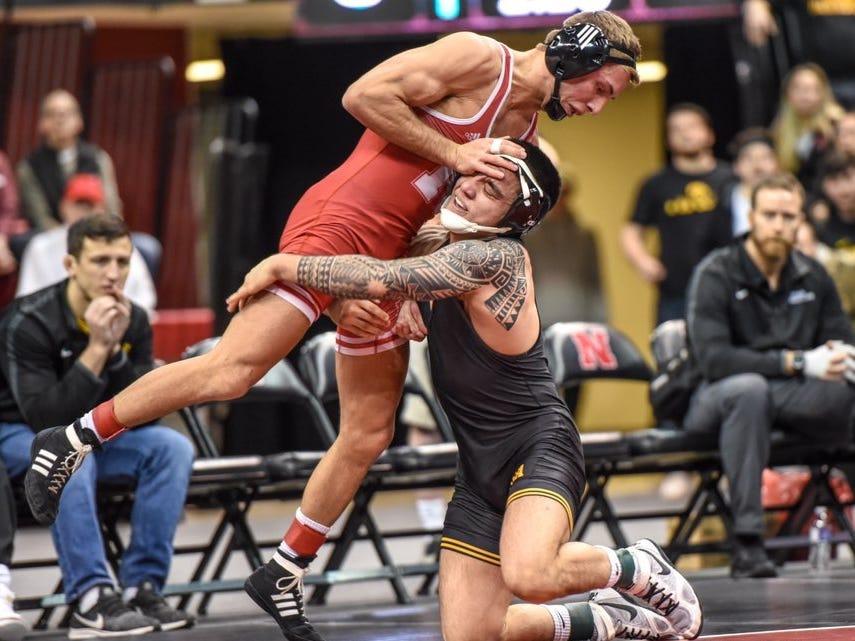 Iowa's Pat Lugo works for a takedown against Nebraska's Jordan Shearer during Sunday's dual at the Bob Devaney Sports Center in Lincoln, Nebraska on Sunday, Feb. 3, 2019. Lugo won, 8-4.