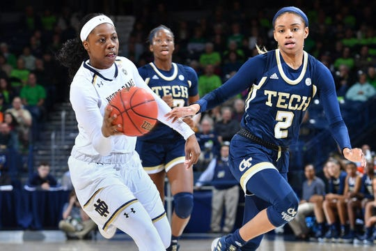 Feb 3, 2019; South Bend, IN, USA; Notre Dame Fighting Irish guard Arike Ogunbowale (24) passes the ball as Georgia Tech Yellow Jackets guard Jasmine Carson (2) defends in the second half at the Purcell Pavilion.