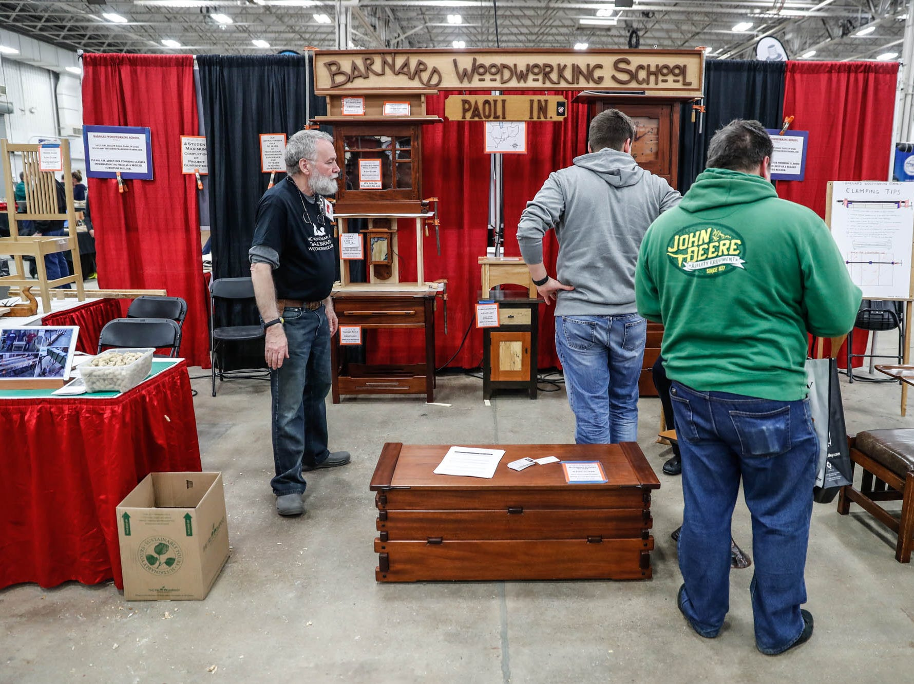 Guests look through the Barnard Woodworking School booth during a Wood Working Show at the Indiana State Fairgrounds in Indianapolis on Sunday, Feb. 3, 2019.