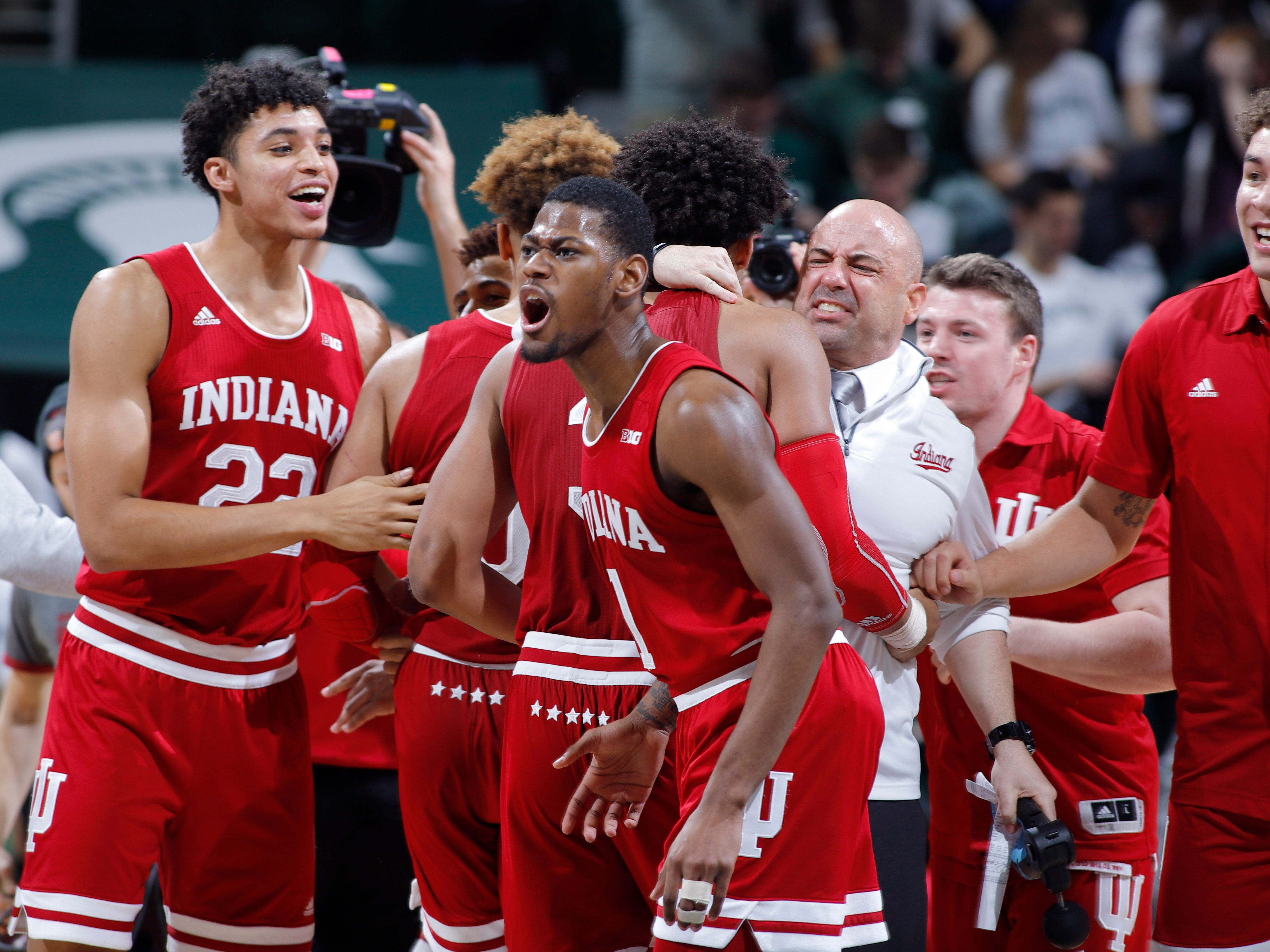 Indiana players and coaches celebrate following a 79-75 overtime win over Michigan State in an NCAA college basketball game, Saturday, Feb. 2, 2019, in East Lansing, Mich.