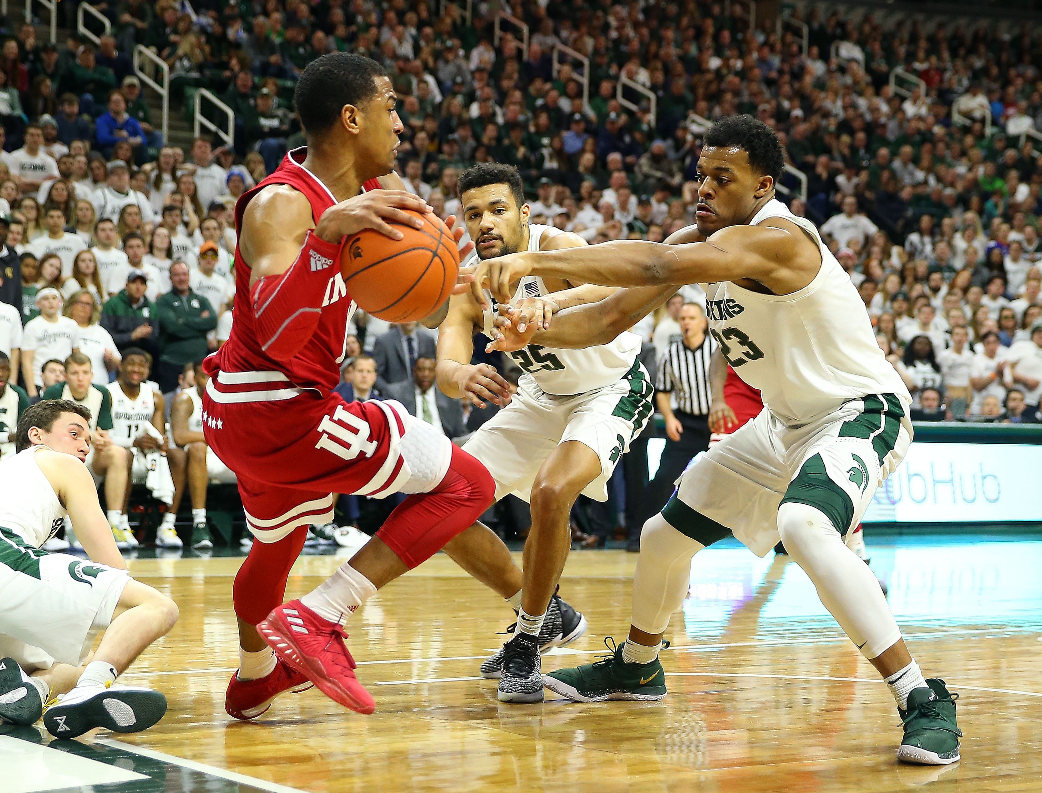 Indiana Hoosiers guard Aljami Durham (1) is defended by Michigan State Spartans forward Xavier Tillman (23) during the first half  at the Breslin Center.