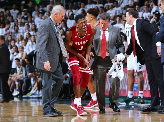 EAST LANSING, MI - FEBRUARY 02: Aljami Durham #1 of the Indiana Hoosiers is help off the court in the in the second half during a game against the  Michigan State Spartan at Breslin Center on February 2, 2019 in East Lansing, Michigan. (Photo by Rey Del Rio/Getty Images)
