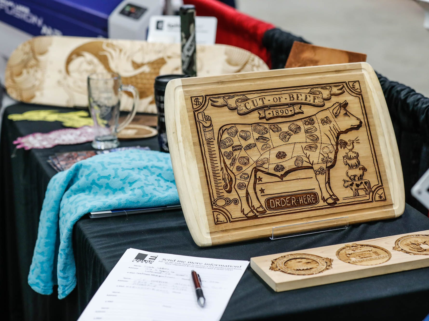 Laser cut items are on display in the Epilog Laser booth during a Wood Working Show at the Indiana State Fairgrounds in Indianapolis on Sunday, Feb. 3, 2019.