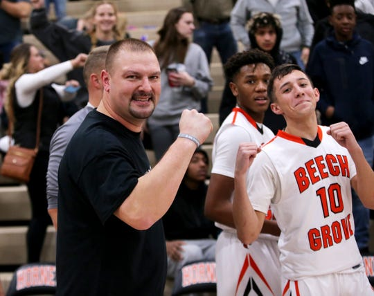 Beech Grove coach Mike Renfroe posing with Josh Coppenhaver (10).