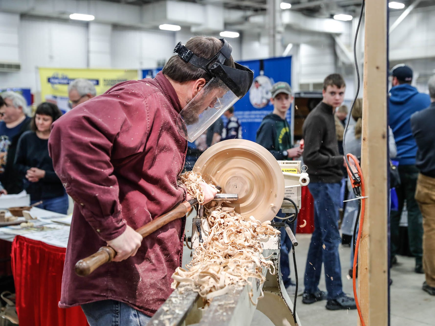 Tim Kennedy turns a wooden bowl during a Wood Working Show at the Indiana State Fairgrounds in Indianapolis on Sunday, Feb. 3, 2019.